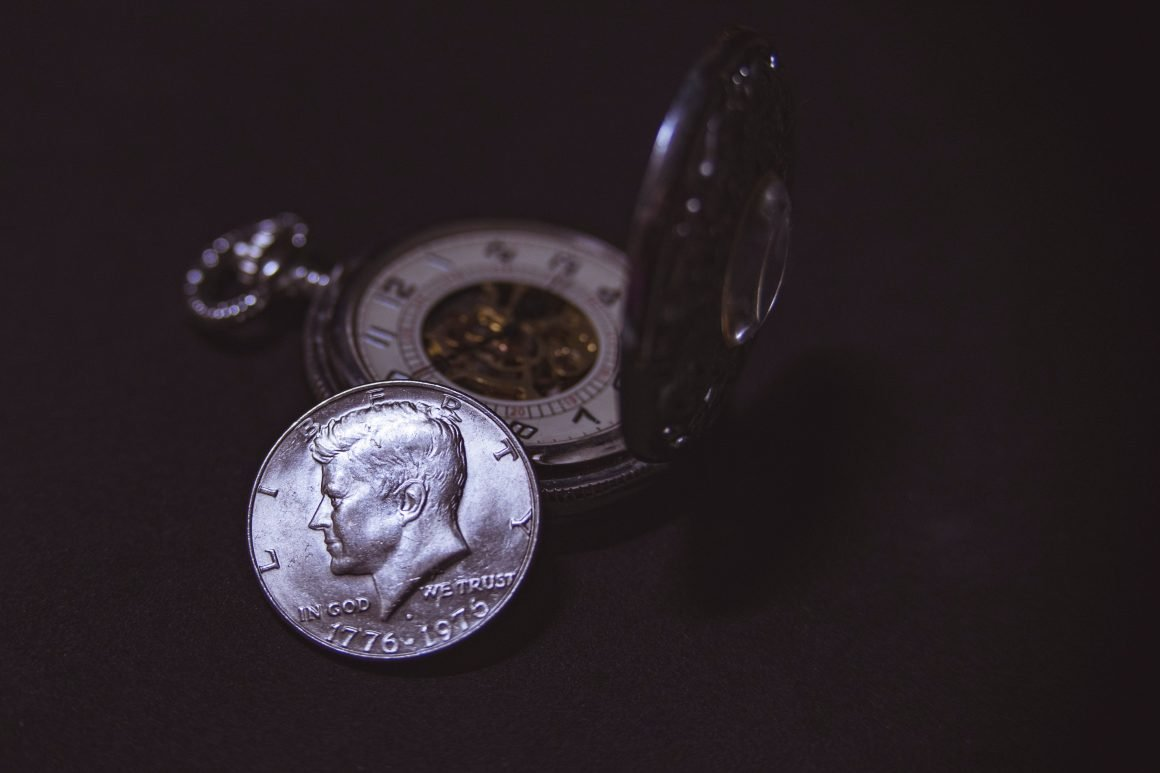 Photo of coin and pocket watch
